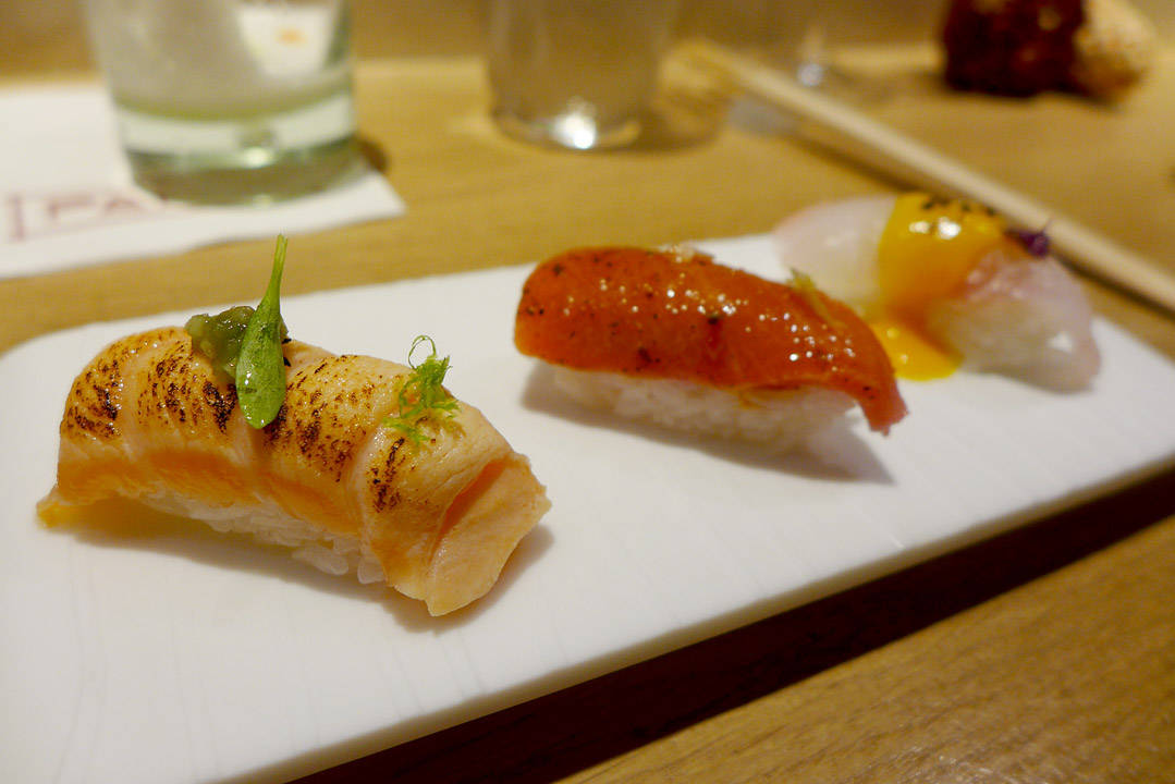 "The Nigiris: Market fish nigiri with smoked ""ají Amarillo"" Tuna nigiri with ""anticuchera"" sauce Salmon nigiri with aburi. En nytelse."