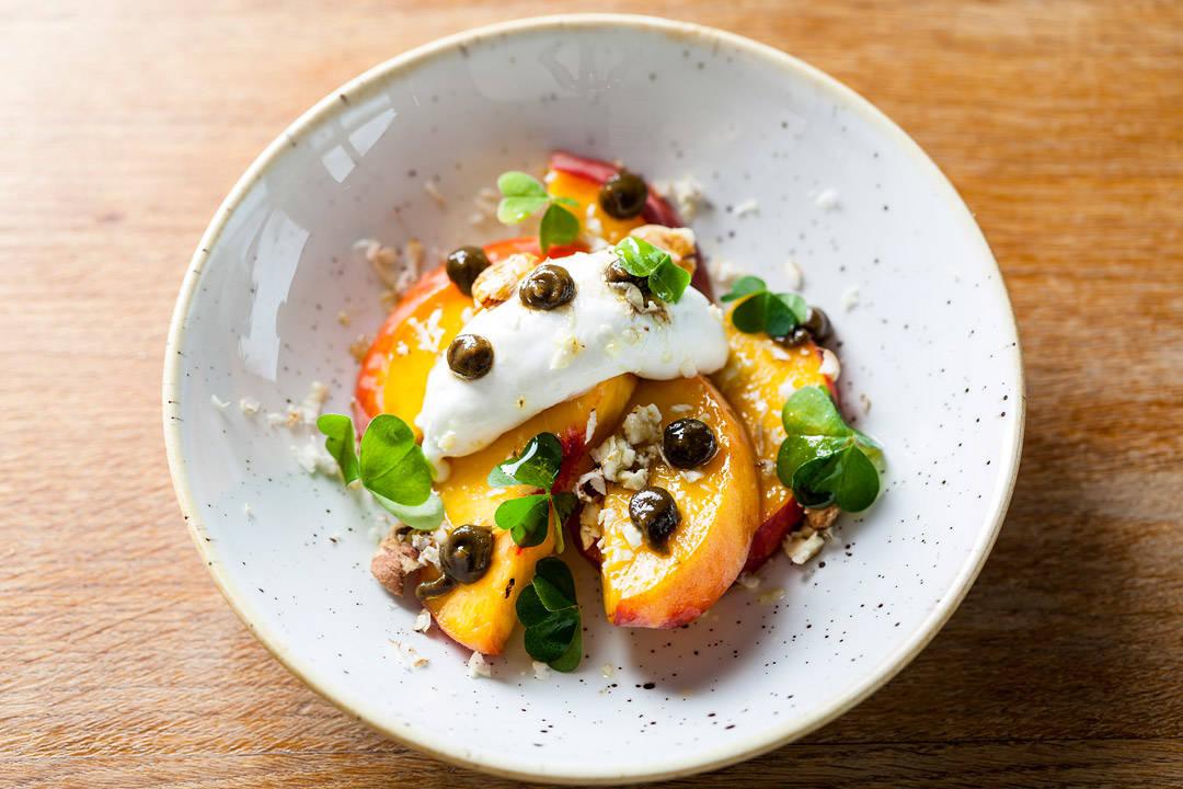 Italian peach, Welsh goat's cheese, Kentish cobnuts, wood sorrel, pickled walnut dressing; Duck & Waffle, 110 Bishopsgate, London EC2N 4AY, tel 020 3640 7310
